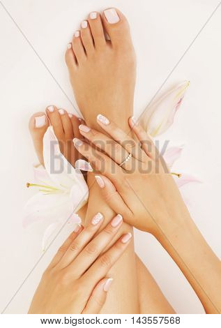 womans manicure pedicure with flower lily close up isolated on white perfect shape hands spa salon poster