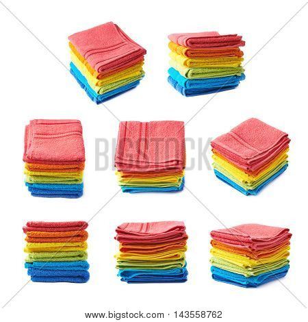 Pile of multiple rainbow colored towels isolated over the white background, set collection of eight different foreshortenings