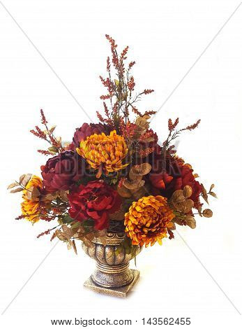 Artificial colorful fall flowers in flowerpot, white background