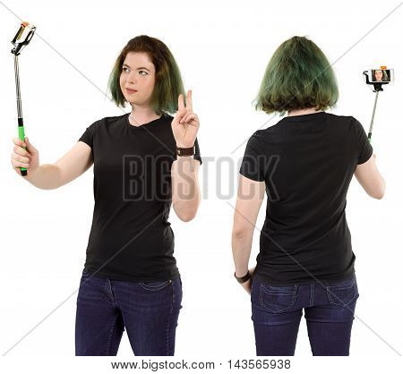 Photo of a woman with green hair posing for a selfie and wearing a blank black t-shirt ready for your artwork or design.