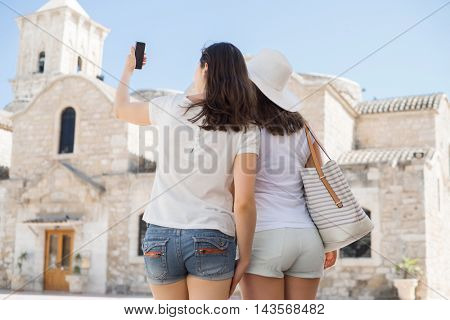 Girls on a city tour. Young and beautiful women have a weekend in Larnaca. Vacation, holidays and traveling concept.
