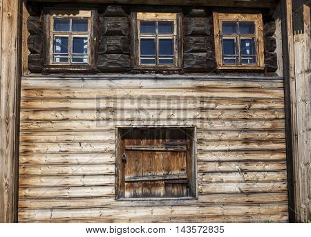 Old door and window on the wooden wall of a village house. Excellent background