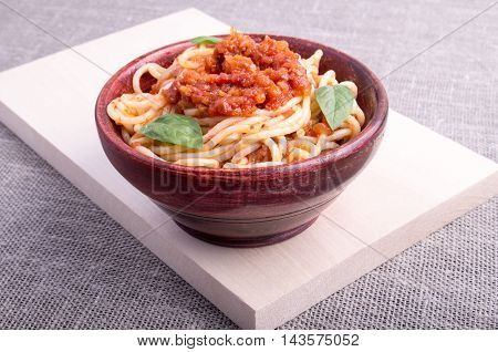 Cooked Spaghetti In A Brown Small Wooden Bowl