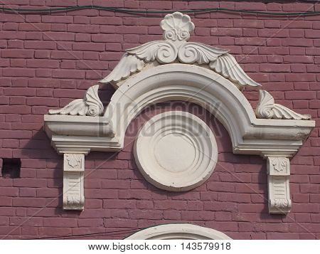 The stucco molding on a house wall made of plaster, decorates a building facade