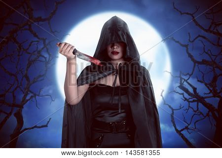 Halloween Witch Woman In The Night With Noonlight With Fog Background And Creepy