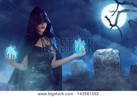 Asian Beauty Witch Woman With Blue Fire On Her Hand