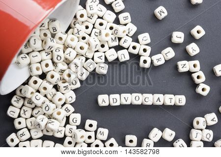 Advocate word written on wood block. Wooden ABc.