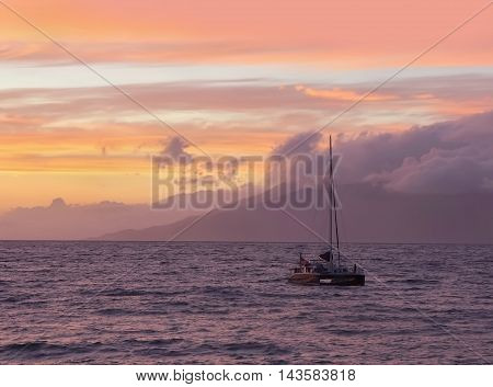 Landscape with sunset sky, ocean and boat.