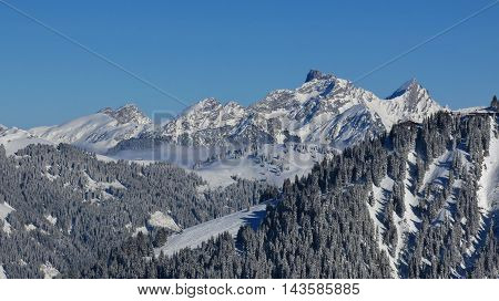 Winter scene in Gstaad. View from Mt Wispile. Wasserngrat and distant view of Mt Spillgerten.
