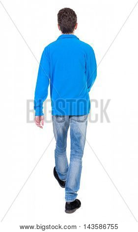 Back view of going  handsome man. walking young guy . Rear view people collection.  backside view of person.  Isolated over white background. Curly boy in a warm blue sweater goes away.