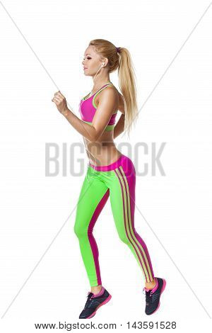 Running fitness woman with earphones isolated. Female runner in sporty pink and green fitness outfit jogging isolated on white background. Beautiful mixed race Asian Caucasian fitness model training.