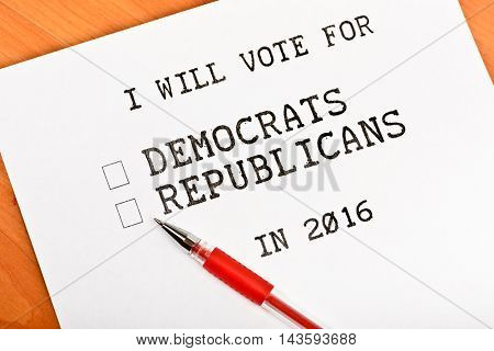 Sheet of paper with words democrat and republican with check boxes on wooden table