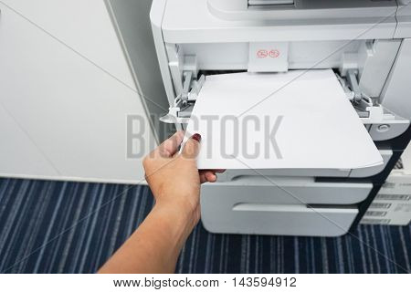 Insert paper into the printer for printing business documents