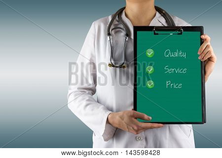 Quality - Service - Price - Female doctor's hand holding medical clipboard, stethoscope. Concept of Healthcare And Medicine. Copy space.