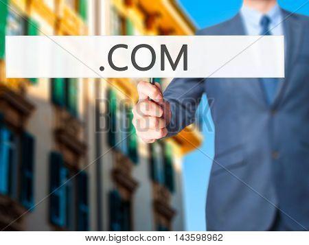 .com - Businessman Hand Holding Sign