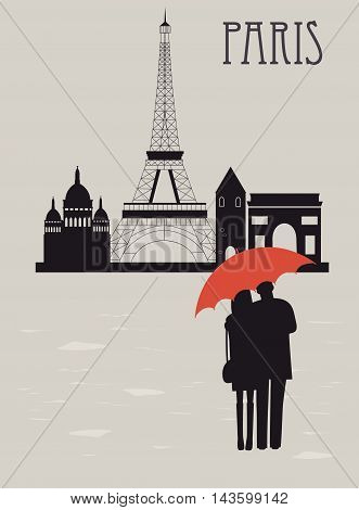 Man and woman with umbrella in Paris in rainy day.