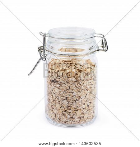 Glass jar filled with the oatmeal flakes isolated over the white background