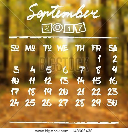 Calendar design grid in hand written style with white lettering and dates of autumn month September 2017 on natural blurred background. Autumn landscape. Vector illustration