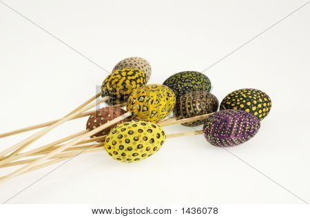 Colored Eggs On Wooden Sticks