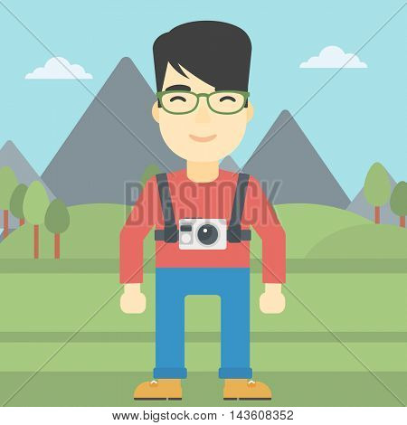 An asian man with a digital camera on his chest. Tourist with a digital camera standing on the background of mountains. Vector flat design illustration. Square layout.