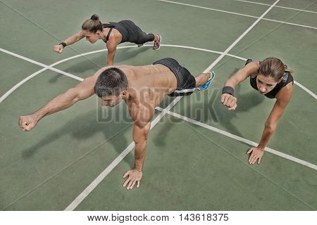 High plank punches exercise insanity workout, high angle view