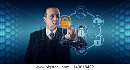 Businessman with concentrated look is activating a lock icon for fraud prevention. Information technology and cybersecurity concept for data protection penetration testing and incident management.