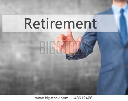 Retirement - Businessman Hand Pressing Button On Touch Screen Interface.
