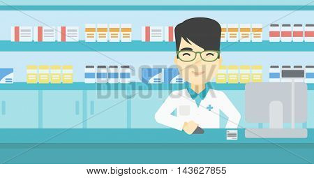 An asian young pharmacist in medical gown standing at pharmacy counter and working on a computer. Male pharmacist in the drugstore. Vector flat design illustration. Horizontal layout.