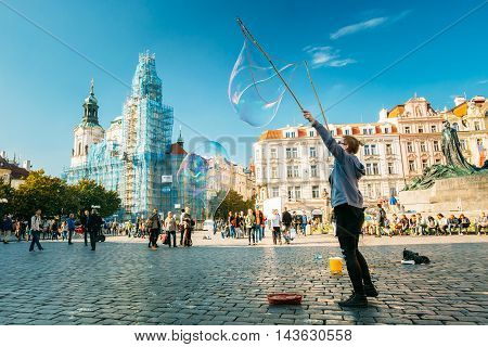 Prague, Czech Republic - October 15, 2014: Unidentified Young Woman Makes Soap Bubbles In Old Town Square - Staromestske Namesti In Prague, Czech Republic