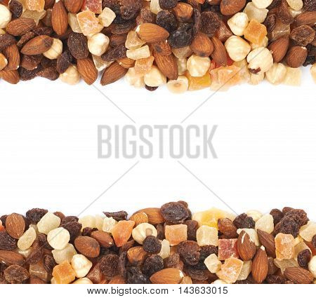 Copyspace composition with the borders made of nuts and dried fruit bits isolated over the white background
