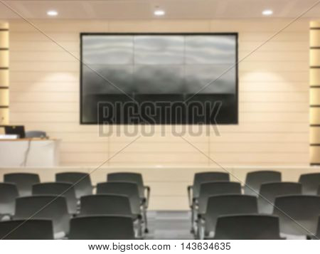 Motion blur of view of empty seminar after finish meeting and audience go out in a seminar room background