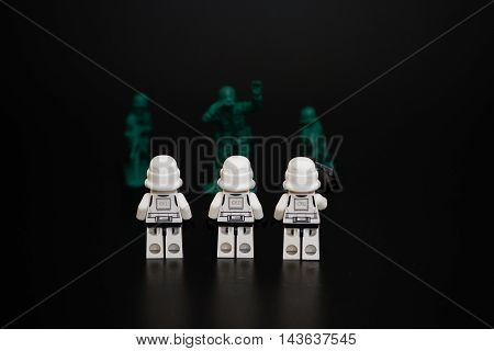 Orvieto Italy - November 22th 2015: Group of Star Wars Lego Stormtroopers minifigures repair vs. human soldier. Lego is a popular line of construction toys manufactured by the Lego Group