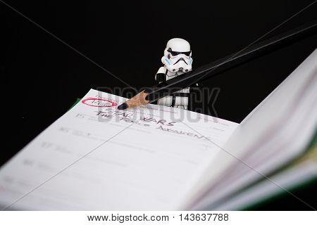 Orvieto, Italy - November 22th 2015: Group of Star Wars Lego Stormtroopers an notepad. Date new film of Ster Wars. Lego is a popular line of construction toys manufactured by the Lego Group