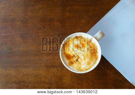 Hot Coffee Caramel Macchiato On Wooden Table