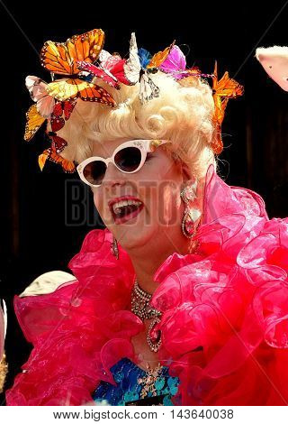 New York City - April 20 2014: Duchess Doris Dear sporting shades a frilly boat and a butterly bonnet at the Easter Parade on Fifth Avenue