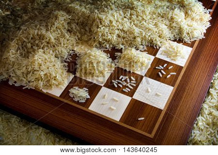 chessboard with exponential growing heaps of rice grains legendary metaphor of unlimited growth