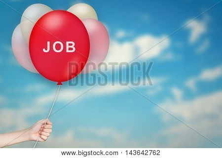 Hand Holding job Balloon with sky blurred background