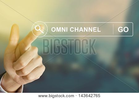 business hand clicking omni channel button on search toolbar with vintage style effect