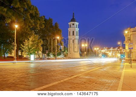 Cathedral of St. Stanislaus and the bell tower in the center of Vilnius at night.