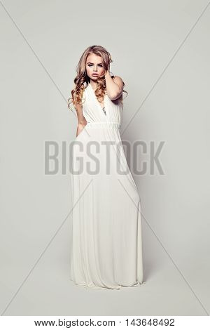 Perfect Woman Fashion Model with white dress. Full Portrait