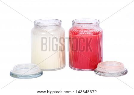 White and red candles in house warmer house jar separated on white background