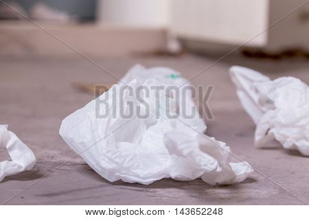 Plastic bags littered on the street - environmental and plastic garbage concern concept