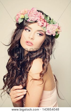 Gentle Floral Portrait of Woman Fashion Model. Curly Hair Beauty Makeup and Peony Flowers