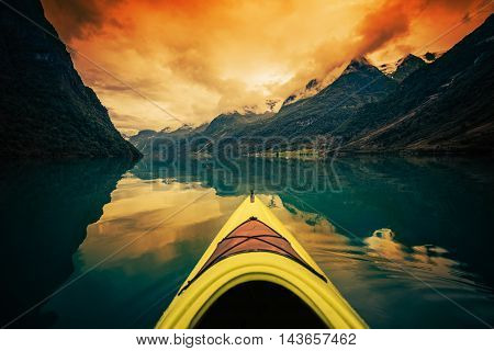 Kayaking Scenic Glacier Lake in Norway. Oldevatnet Lake near Briksdalsbre Glacier in Western Norway. Sunset Scenery.
