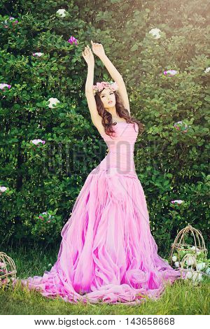Fashion Girl in Pink Dress Outdoors. Beauty Photo