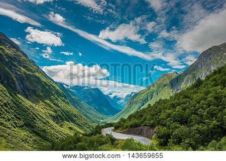 Scenic Winding Road in Norway. Green Summer Valley near Stryn Norway. Mountain Valley Landscape.