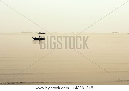 fishing boat and sea in the evening