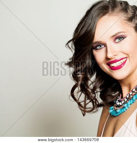 Beauty Fashion Happy Model Girl with Curly Hairstyle and Beautiful Smile. Laughing Young Woman