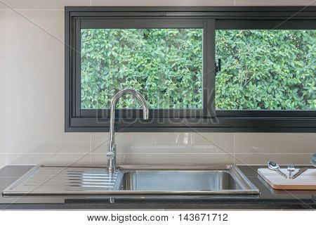 Kitchen Sink With Faucet On Black Counter