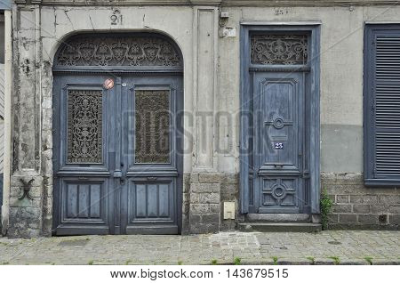 Lille France - July 23 2016: Grey residential entrance door and gate in the Vieux-Lille quarter